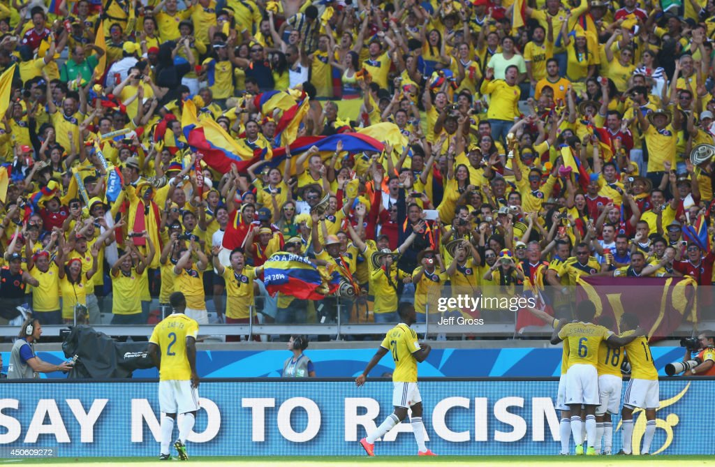 Colombia celebrate the team's third goal scored by <a gi-track='captionPersonalityLinkClicked' href=/galleries/search?phrase=James+Rodriguez&family=editorial&specificpeople=4422074 ng-click='$event.stopPropagation()'>James Rodriguez</a> (obscured) during the 2014 FIFA World Cup Brazil Group C match between Colombia and Greece at Estadio Mineirao on June 14, 2014 in Belo Horizonte, Brazil.