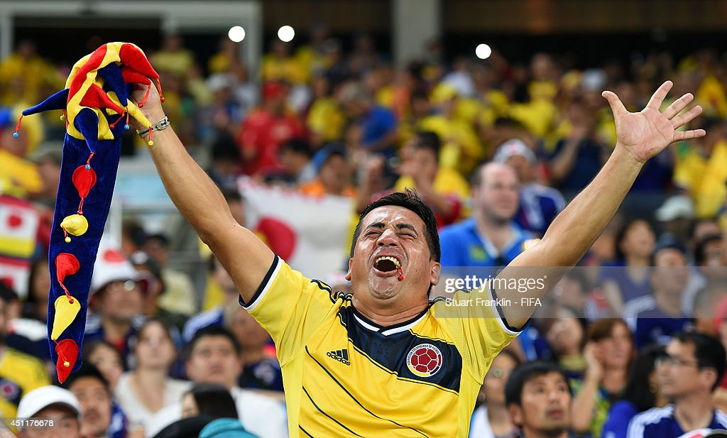 A Colombia fan celebrates the third goal during the 2014 FIFA World Cup Brazil Group C match between Japan and Colombia at Arena Pantanal on June 24, 2014 in Cuiaba, Brazil.