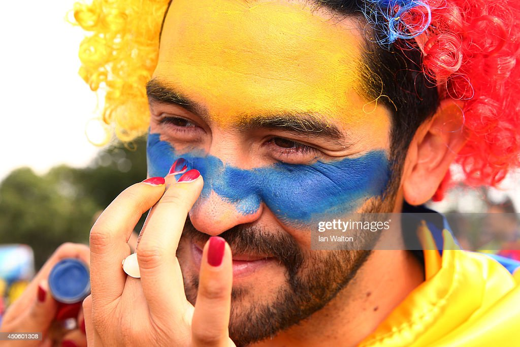 A Colombia fan has his face painted prior to the 2014 FIFA World Cup Brazil Group C match between Colombia and Greece at Estadio Mineirao on June 14, 2014 in Belo Horizonte, Brazil.