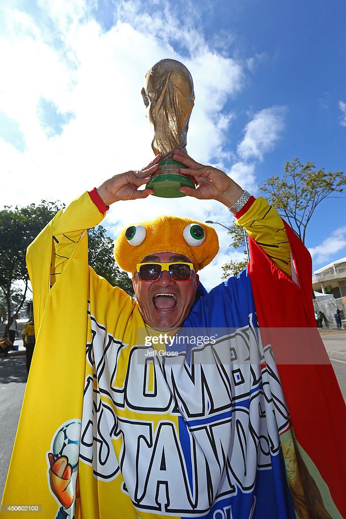 A Colombia fan holds a replica of the World Cup trophy prior to the 2014 FIFA World Cup Brazil Group C match between Colombia and Greece at Estadio Mineirao on June 14, 2014 in Belo Horizonte, Brazil.