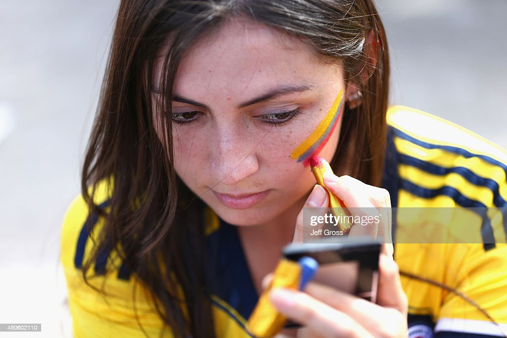 A Colombia fan paints her face prior to the 2014 FIFA World Cup Brazil Group C match between Colombia and Greece at Estadio Mineirao on June 14, 2014 in Belo Horizonte, Brazil.
