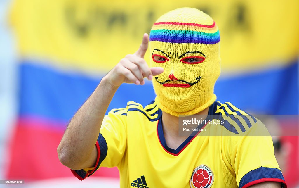 A Colombia fan wearing a mask enjoys the atmosphere prior to the 2014 FIFA World Cup Brazil Group C match between Colombia and Greece at Estadio Mineirao on June 14, 2014 in Belo Horizonte, Brazil.