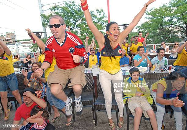Colombia fans celebrate after James Rodriguez scored in the second half during the Colombia vs Brazil World Cup quarterfinal match viewing party at...