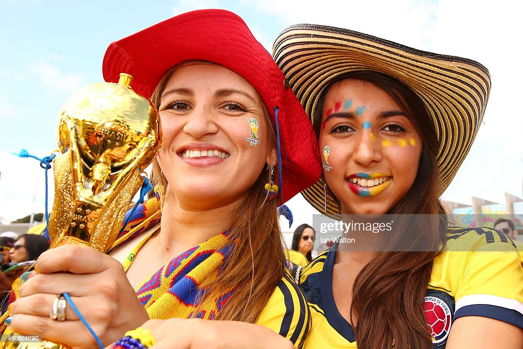 Colombia fans enjoy the atmosphere while holding a replica of the World Cup trophy prior to the 2014 FIFA World Cup Brazil Group C match between Colombia and Greece at Estadio Mineirao on June 14, 2014 in Belo Horizonte, Brazil.