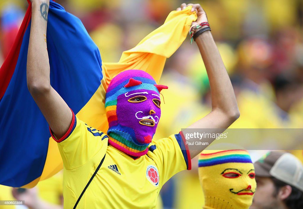 Colombia fans wearing masks enjoy the atmosphere prior to the 2014 FIFA World Cup Brazil Group C match between Colombia and Greece at Estadio Mineirao on June 14, 2014 in Belo Horizonte, Brazil.