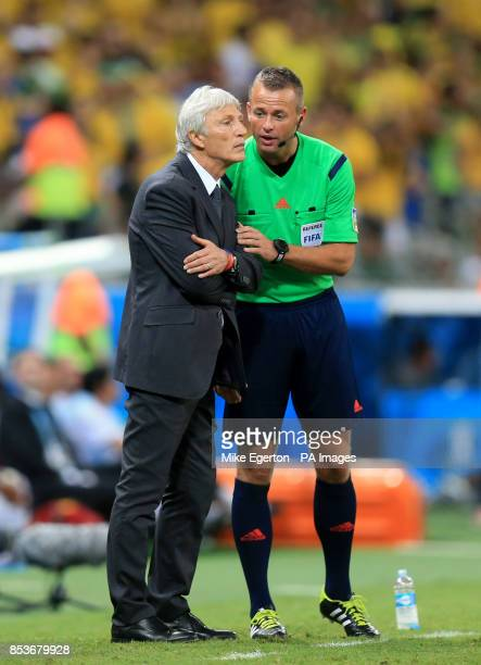 Colombia manager Jose Pekerman has a word with the fourth official on the touchline during the quarter final match at the Estadio Castelao Fortaleza
