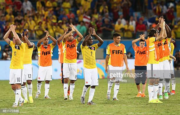 Colombia players acknowledge the fans after a 41 victory over Japan the 2014 FIFA World Cup Brazil Group C match between Japan and Colombia at Arena...