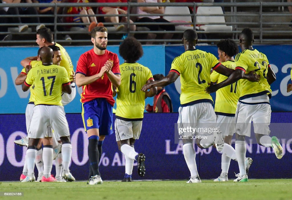 Colombia players celebrate a goal during the friendly international football match Spain vs Colombia at the Condomina stadium in Murcia on June 7, 2017. /