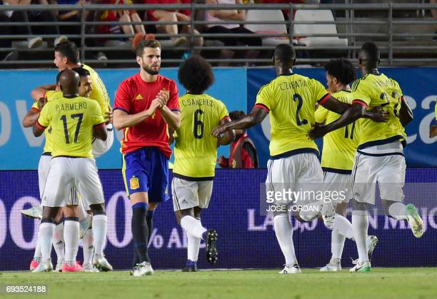 Colombia players celebrate a goal during the friendly international football match Spain vs Colombia at the Condomina stadium in Murcia on June 7...