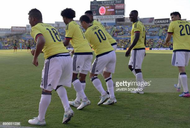 Colombia players dance as they celebrate a goal during the friendly football match Cameroon vs Colombia at the Col Alfonso Perez stadium in Getafe on...