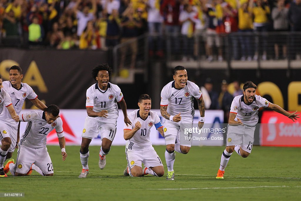 Colombia players react to David Ospina #1 of Colombia final save to win the penalty shoot out players include Juan Cuadrado #11, <a gi-track='captionPersonalityLinkClicked' href=/galleries/search?phrase=James+Rodriguez&family=editorial&specificpeople=4422074 ng-click='$event.stopPropagation()'>James Rodriguez</a> #10, Dayro Moreno #17 and Sebastian Perez #13 of Colombia during the Colombia Vs Peru Quarterfinal match of the Copa America Centenario USA 2016 Tournament at MetLife Stadium on June 17, 2016 in East Rutherford, New Jersey.