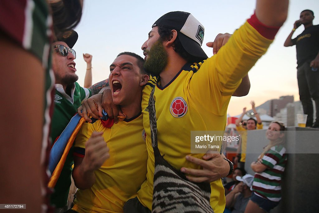 Colombia supporters celebrate after their first goal against Japan while watching at the FIFA Fan Fest on Copacabana Beach on June 24, 2014 in Rio de Janeiro, Brazil.