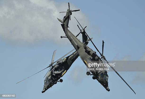 Colombian Air Force pilots on their Blackhawk Arpia helicopters perform acrobatics during the FAir Colombia 2015 air festival at the Jose Maria...