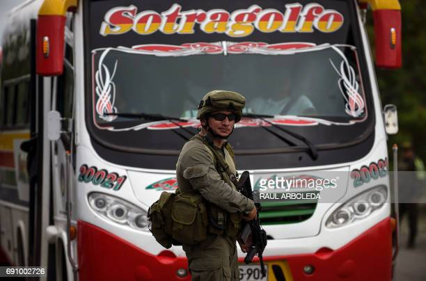 A Colombian antinarcotics police officer takes part in a patrol to hand out pamphlets offering rewards for information leading to the capture of...