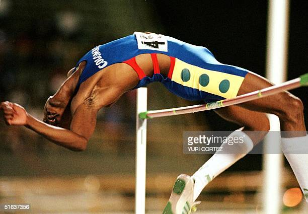 Colombian athlete Gilmer Mayo jumps in the men's high jump finals 20 August in the Panchencho Romero Stadium during the Central American and...