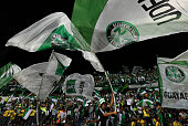 Colombian Atletico Nacional supporters cheer for their team before the start of the Libertadores Cup final match against Ecuadorean Independiente del...