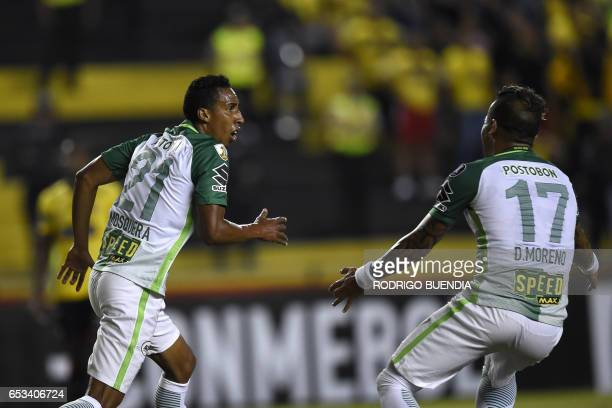 Colombian Atletico Nacional's Jhon Mosquera celebrates with teammate Dayron Moreno his goal against Barcelona from Ecuador during their Copa...