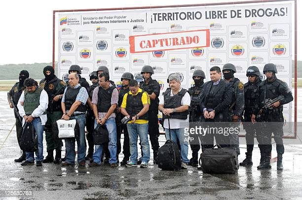 Colombian citizens Jorge Reyes Jorge Santaella Raul Pena Ruberney Vergara Yesid Rios and Didier Rios are escorted by police officers before being...
