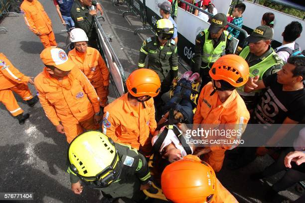 Colombian civil defence personnel help Venezuelans cross the Simon Bolivar bridge linking San Antonio del Tachira in Venezuela with Cucuta Colombia...