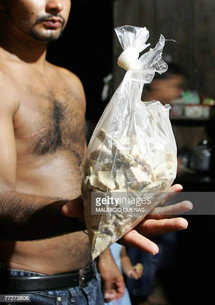 A Colombian coca grower shows a plastic bag with freebase cocaine 10 October 2007 at a farm in the Nario department Colombia Peasants who had their...