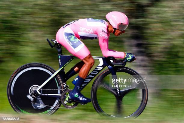 Colombian cyclist Nairo Quintana from Movistar Team wearing the overall's leader pink jersey rides during the 10th stage an individual timetrial...
