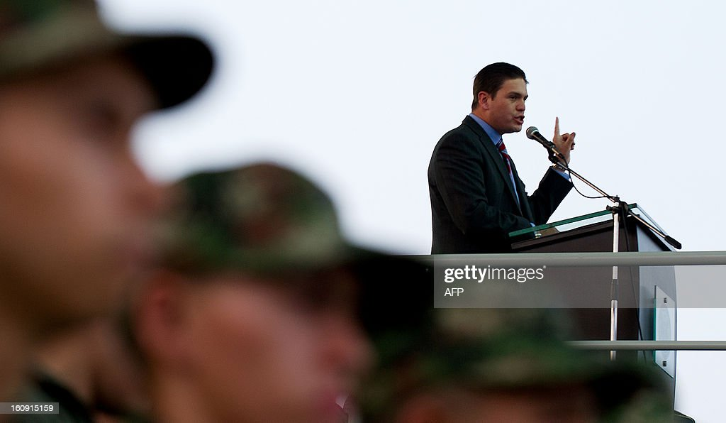 Colombian Defense Minister Juan Carlos Pinzon gives a speech on February 7, 2013 in Cali, Valle del Cauca department, Colombia, during the activation ceremony of Air Combat Command number 7 to conduct air operations against of the Revolutionary Armed Forces of Colombia (FARC) guerrillas, a group rebel with high influence in the south of country.