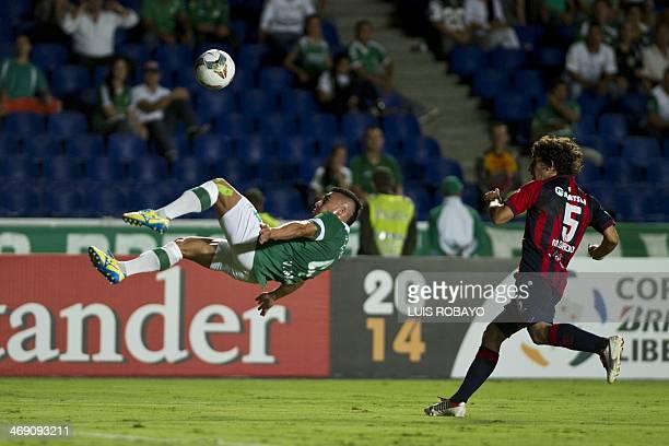 Colombian Deportivo Cali's defender Vladimir Marin kicks the ball next to Paraguayan Cerro Porteno's midfielder Mathias Corujo during their...