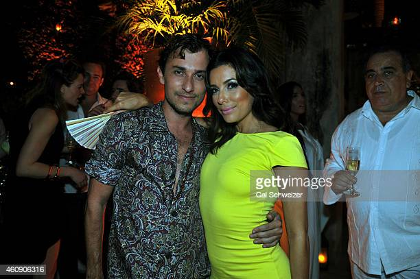 Colombian designer Esteban Cortazar and actress Eva Longoria pose for a photo during the Pre New Year´s Affair in celebration of the Opening of W...