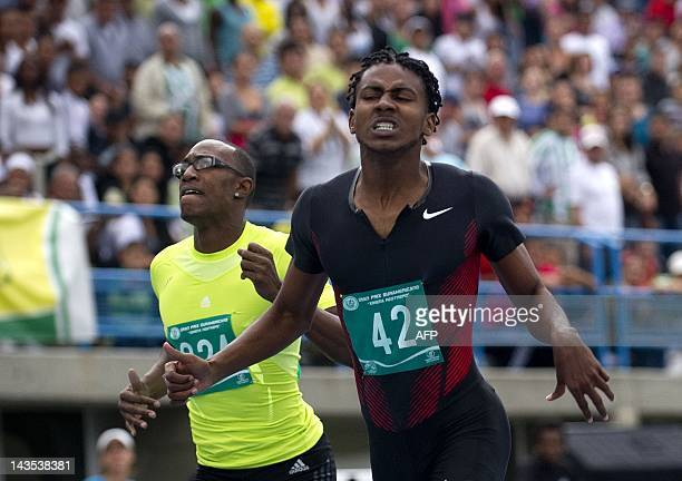 Colombian Diego Palomeque gestures next to Liemarven Bonifacia of Curazao after winning the 400 meters race during the Ximena Restrepo International...