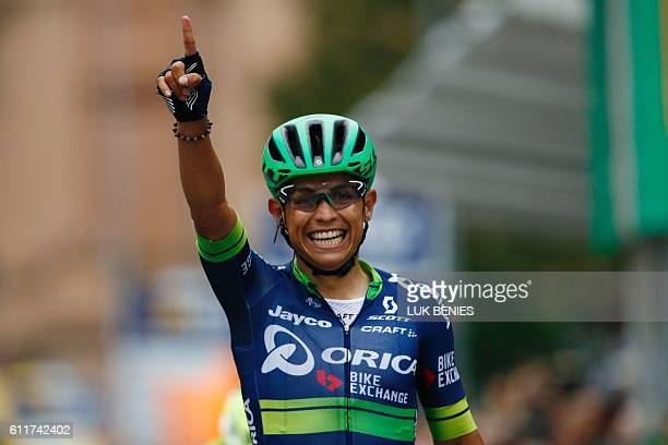 Colombian Esteban Chaves of team Orica celebrates as he crosses the finish line to win the 110th edition of the giro di Lombardia a 241 km cycling...
