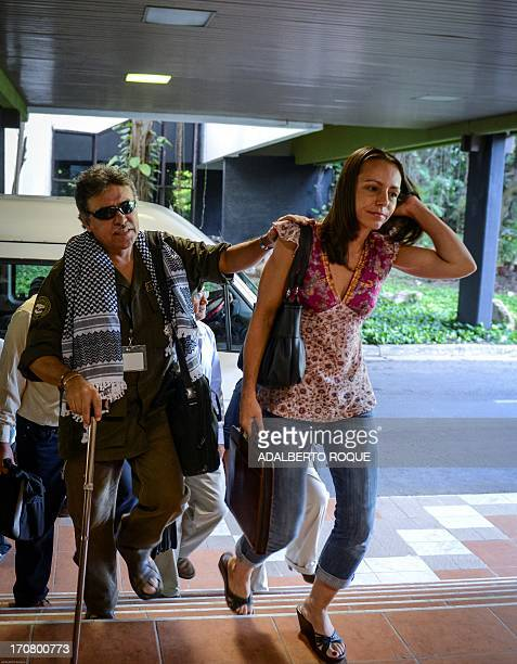Colombian FARCEP Commander Jesus Santrich is helped by guerrilla member Dutch born Tanja Nijmeijer upon their arrival at Convention Palace of Havana...