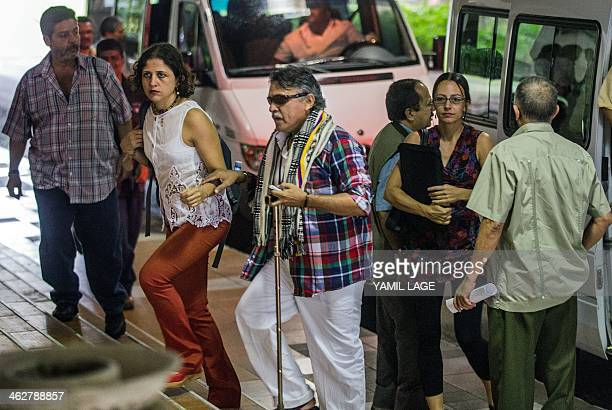 Colombian FARCEP Commander Jesus Santrich walks followed by Dutch born guerrilla member Tanja Nijmeijer upon their arrival at Convention Palace of...