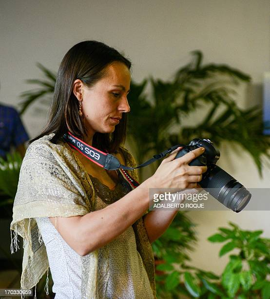 Colombian FARCEP member Dutch born Tanja Nijmeijer takes pictures on June 11 2013 at Convention Palace in Havana where the PeaceTalks between FARC...