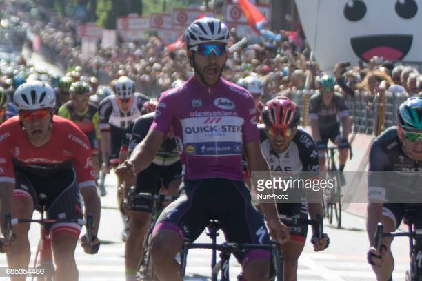 Colombian Fernando Gaviria of the Quick Step team celebrates as he crosses the finish line to win the 13th stage of the 100th Giro d'Italia Tour of...