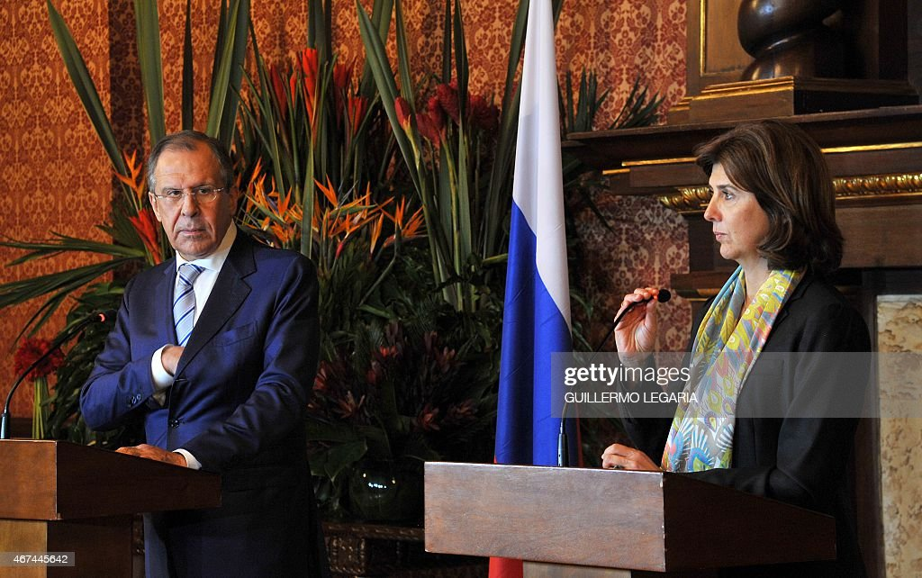 Colombian Foreign Minister <a gi-track='captionPersonalityLinkClicked' href=/galleries/search?phrase=Maria+Angela+Holguin&family=editorial&specificpeople=7133255 ng-click='$event.stopPropagation()'>Maria Angela Holguin</a> (R) and her Russian counterpart <a gi-track='captionPersonalityLinkClicked' href=/galleries/search?phrase=Sergei+Lavrov&family=editorial&specificpeople=542406 ng-click='$event.stopPropagation()'>Sergei Lavrov</a> take part in a joint press conference after a meeting at San Carlos Palace on March 24, 2015 in Bogota.