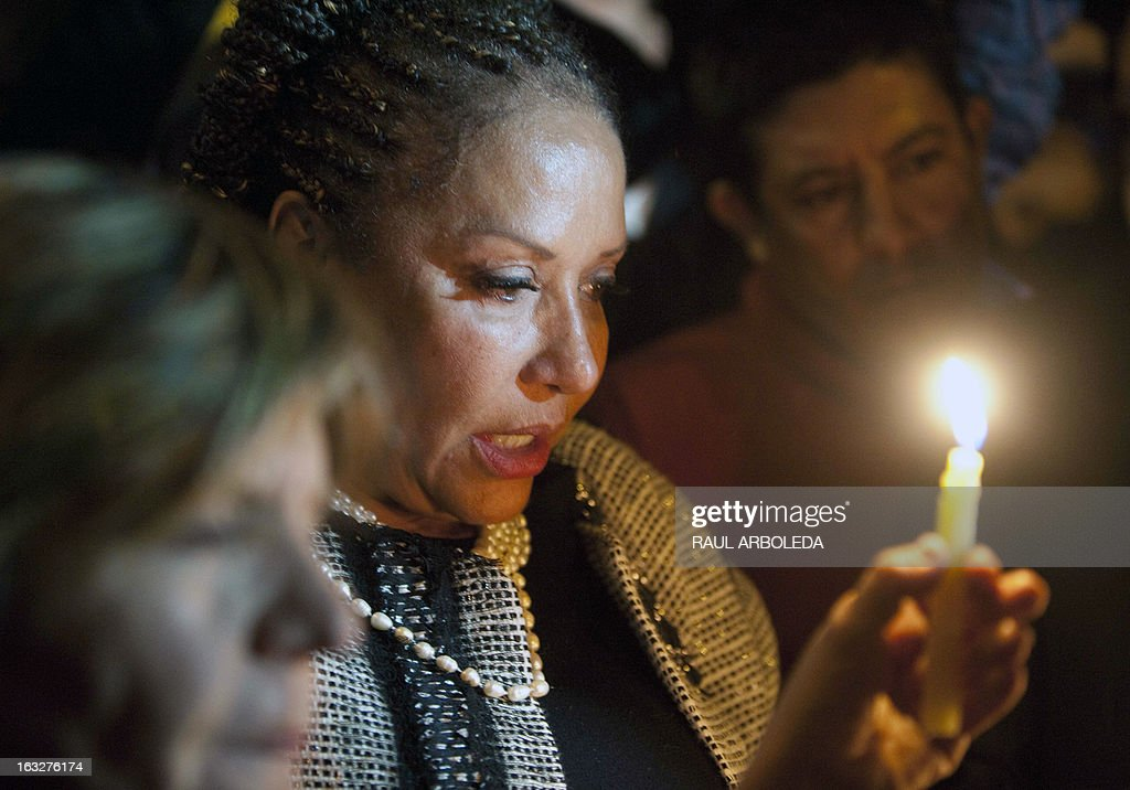 Colombian former Senator Piedad Cordoba holds a candle outside the Venezuelan embassy in Bogota, Colombia on March 6, 2013, after Venezuelan President Hugo Chavez's death. The flag-draped coffin of Venezuelan leader Hugo Chavez was borne through throngs of weeping supporters on Wednesday as a nation bade farewell to the firebrand leftist who led them for 14 years. AFP PHOTO / Raul ARBOLEDA