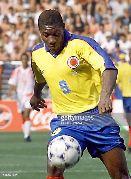 Colombian forward Adolfo Valencia controls the ball 22 June at the Stade de la Mosson in Montpellier during the World Cup second firstround Group G...