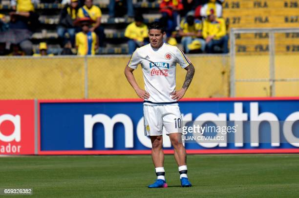 Colombian forward James Rodriguez is seen before the start of the 2018 FIFA World Cup qualifier football match against Ecuador in Quito on March 28...