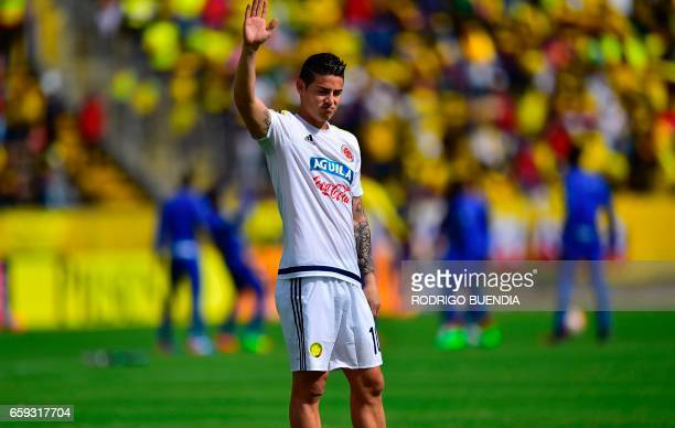 Colombian forward James Rodriguez waves before the start of the 2018 FIFA World Cup qualifier football match against Ecuador in Quito on March 28...