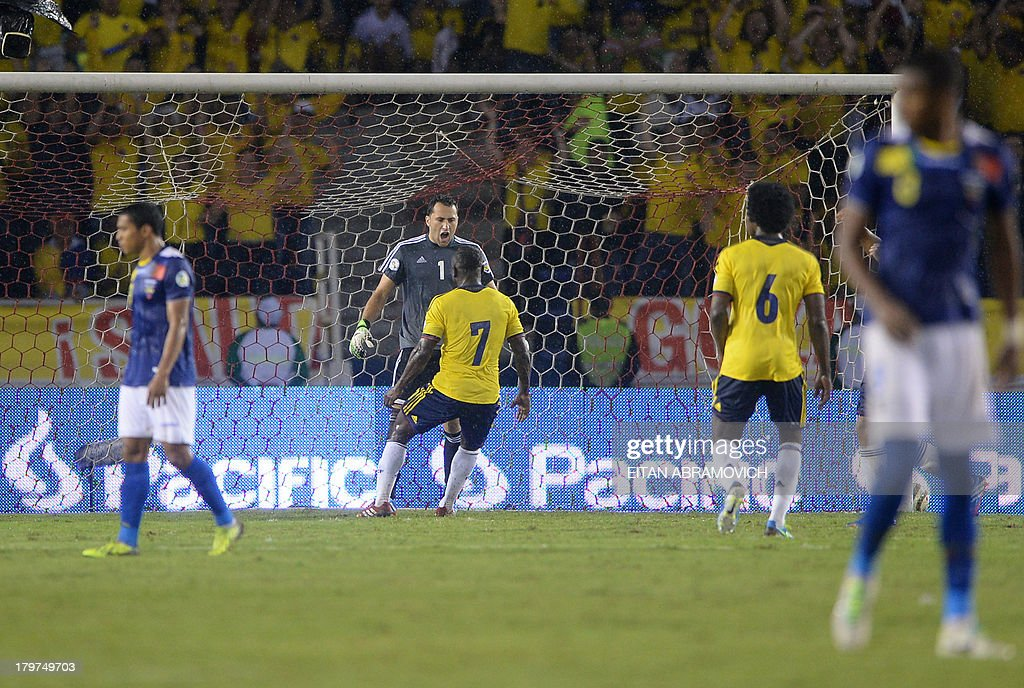 Colombian goalkeeper David Ospina (C) celebrates with teammate Colombian defender Pablo Armero after saving a penalty kick shot by Ecuadorean defender Walter Ayovi during their Brazil 2014 FIFA World Cup South American qualifier match, in Barranquilla, Colombia, on September 6, 2013.