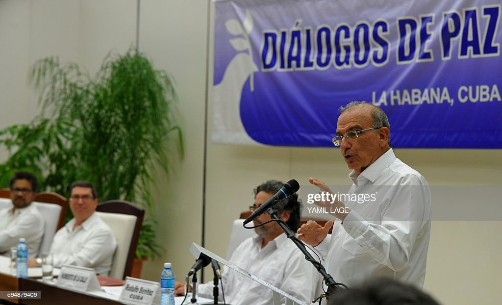 Colombian government head of delegation for peace talks Humberto de la Calle delivers a speech next to FARCEP Commander Ivan Marquez upon the signing...
