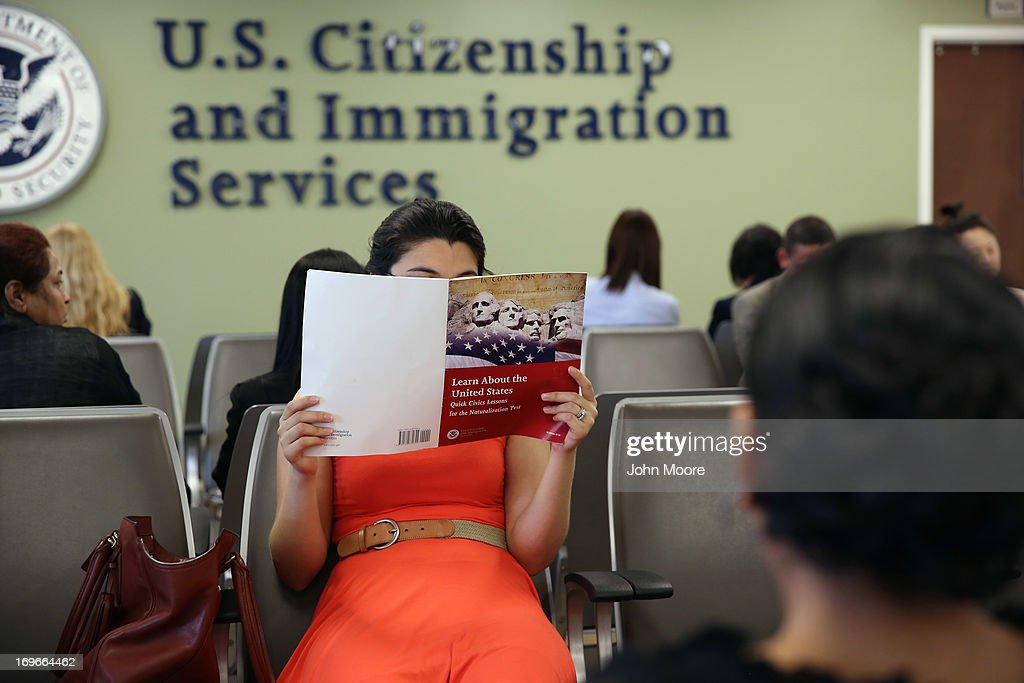 A Colombian immigrant studies ahead of her citizenship exam at the U.S. Citizenship and Immigration Services (USCIS) Queens office on May 30, 2013 in the Long Island City neighborhood of the Queens borough of New York City. The branch office is located in an area heavily populated by immigrants and processes thousands of Green Card and U.S. citizenship applications each year.