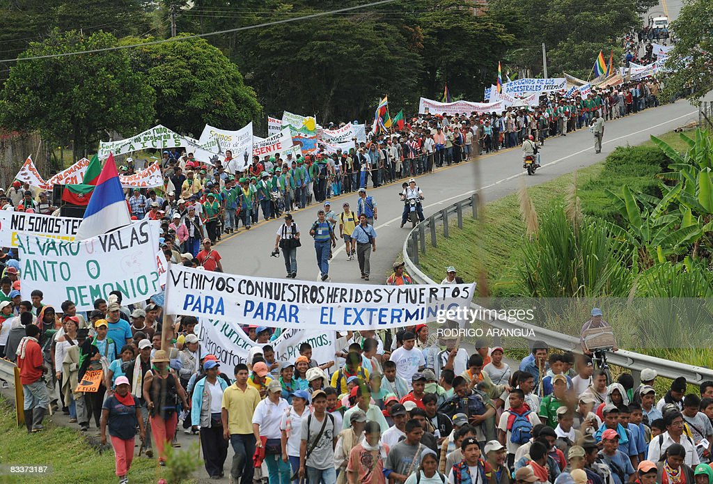 Colombian indigenous people from different ethnic groups march along the Pan American highway on October 21 2008 in Piendamo on their way to...