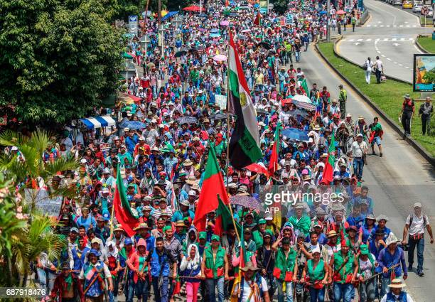 TOPSHOT Colombian indigenous people take part in the march 'For the protection of territory life and dignity of the towns' in Cali Colombia on May 24...