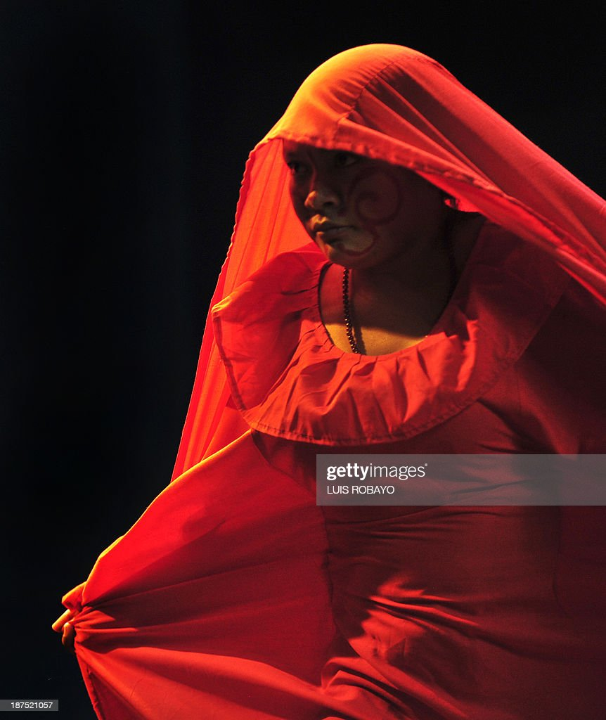 A Colombian indigenous Wayuu ethnic, member of the Wayuu Cultural Group, perform ??the Yonna -- dance typical of their culture -- on November 9, 2013, in Cali, department of Valle del Cauca, Colombia, during the 1st International Dance Biennial of Cali. 600 dancers from dance companies from Mexico, Cuba, United States, Argentina, Korea, Israel, Canada and China, and 18 local companies will perform different genres of dance from November 5 to 11 in Cali. AFP PHOTO / Luis ROBAYO