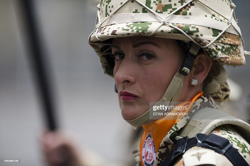 A Colombian infantry female soldier to be deployed as the Multinational Force and Observers (MFO) peacekeeping force in the Sinai peninsula takes part in a military ceremony at Bolivar square in Bogota, Colombia, on April 03, 2013, to mark the 100th reshuffle of the MFO peacekeeping force overseeing the terms of the peace treaty between Egypt and Israel in the Sinai peninsula. AFP PHOTO/Eitan Abramovich