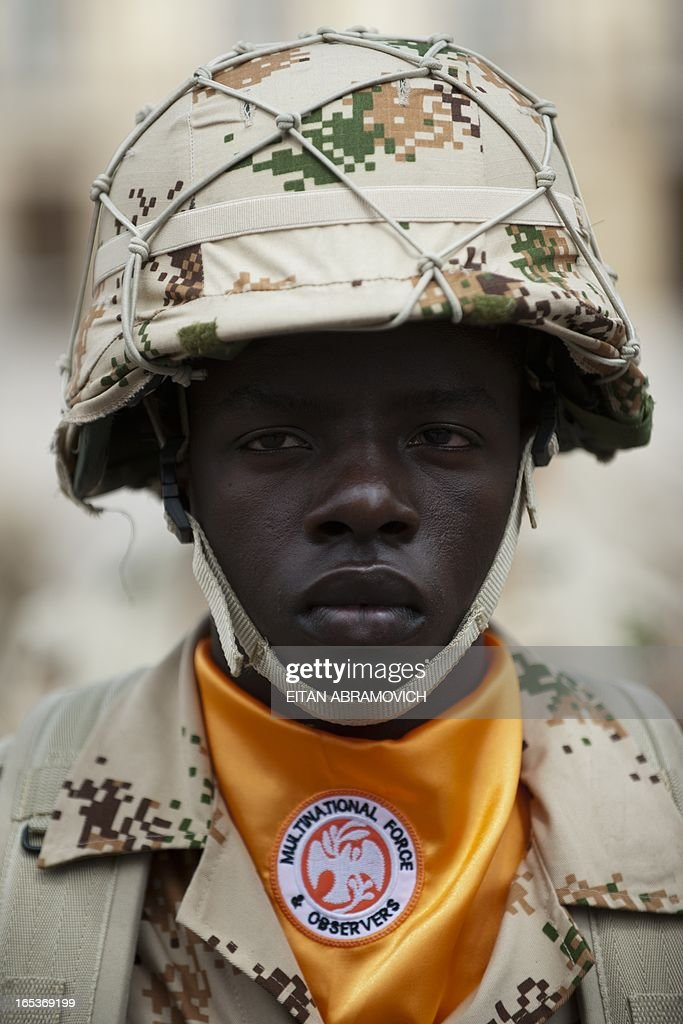 A Colombian infantry soldier to be deployed as the Multinational Force and Observers (MFO) peacekeeping force in the Sinai peninsula falls in during a military ceremony at Bolivar square in Bogota, Colombia, on April 03, 2013, to mark the 100th reshuffle of the MFO peacekeeping force overseeing the terms of the peace treaty between Egypt and Israel in the Sinai peninsula. AFP PHOTO/Eitan Abramovich