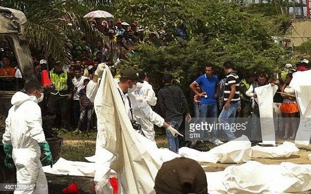 Colombian medical forensic recover bodies of children who died in a burned bus in Fundacion Colombia on May 18 2014 Thirtyone children were burned to...