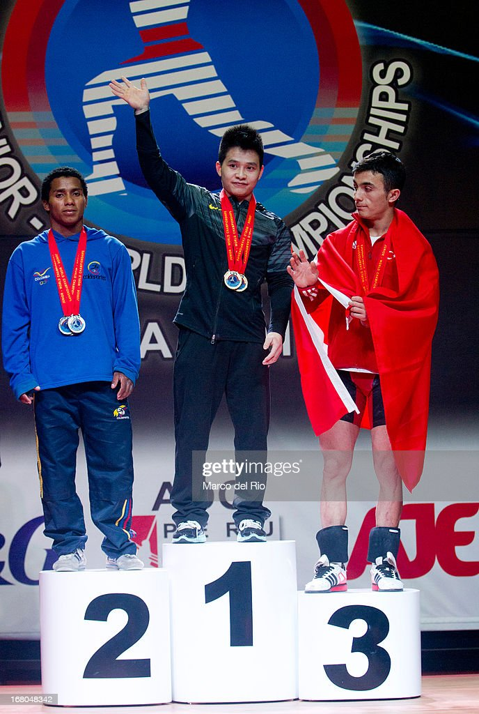 Colombian Mendoza (L), Xiameng Wei of China (C) and Muammer Sahin (R) during podium of the Men's 56kg during day one of the 2013 Junior Weightlifting World Championship at Maria Angola Convention Center on April 04, 2013 in Lima, Peru.