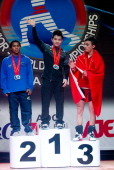 Colombian Mendoza Xiameng Wei of China and Muammer Sahin during podium of the Men's 56kg during day one of the 2013 Junior Weightlifting World...